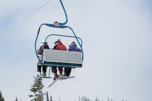 three-skiers-on-ski-lift-picjumbo-com